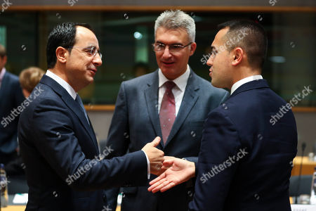 Luigi Di Maio, Carmelo Abela, Nicos Christodoulides. Italian Foreign Minister Luigi Di Maio, right, talks to Cyprus' Foreign Minister Nicos Christodoulides, left, and Malta's Foreign Minister Carmelo Abela during an European Foreign Affairs Ministers meeting at the Europa building in Brussels, . European Union foreign ministers are discussing ways to keep the Iran nuclear deal intact after the Islamic Republic began enrichment work at its Fordo power plant