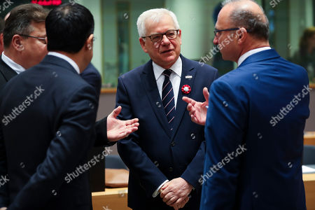 Gordan Grlic Radman, Jacek Czaputowicz, Linas Linkevicius, Carmelo Abela. Polish Foreign Minister Jacek Czaputowicz, second right, talks to Lithuanian Foreign Minister Linas Linkevicius, left, Malta's Foreign Minister Carmelo Abela, second left, and Croatian Foreign Minister Gordan Grlic Radman during an European Foreign Affairs Ministers meeting at the Europa building in Brussels, . European Union foreign ministers are discussing ways to keep the Iran nuclear deal intact after the Islamic Republic began enrichment work at its Fordo enrichment facility