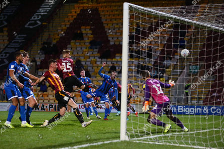 Tyler French of Bradford scores the opening goal