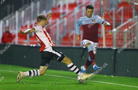 Stock Photo of Alex Hartridge of Exeter City tackles Nathan Holland of West Ham United U21