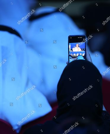 A woman records the speech of former US Secretary of State Condoleezza Rice during the opening ceremony of the Abu Dhabi International Petroleum Exhibition and Conference (ADIPEC) in Abu Dhabi, United Arab Emirates, 11 November 2019. The event runs between 11 and 14 November 2019.
