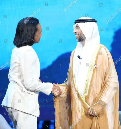 Suhail Mohamed Al Mazrouei (R), Minister of Energy and Industry of the United Arab Emirates, shakes hands with Former US Secretary of State Condoleezza Rice (L) during the opening ceremony of the Abu Dhabi International Petroleum Exhibition and Conference (ADIPEC) in Abu Dhabi, United Arab Emirates, 11 November 2019. The event runs between 11 and 14 November 2019.