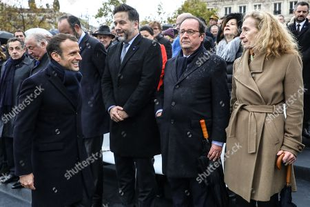 French President Emmanuel Macron (L) salutes (from R) French Justice Minister Nicole Belloubet, former French president Francois Hollande, and French National Assembly vice-president Hugues Renson, at the end of a ceremony at the Arc de Triomphe in Paris, France, 11 November 2019, as part of the commemorations marking the 101st anniversary of the 11 November 1918 armistice, ending World War I (WWI).