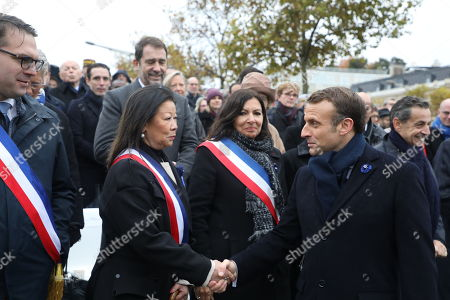 Stock Picture of French President Emmanuel Macron (R) shakes hands with Paris 8th arrondissement mayor Jeanne d'Hauteserre (2ndL), next to Paris Mayor Anne Hidalgo (C) and 17th arrondissement mayor Geoffroy Boulard (L), during a ceremony at the Arc de Triomphe in Paris, France, 11 November 2019, as part of the commemorations marking the 101st anniversary of the 11 November 1918 armistice, ending World War I (WWI).