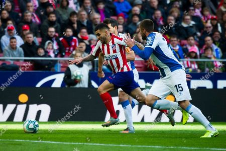 Espanyol's Spanish defender Javi Lopez; Atletico de Madrid's Argentinian forward Angel Correa ; Espanyol's Spanish midfielder David Lopez