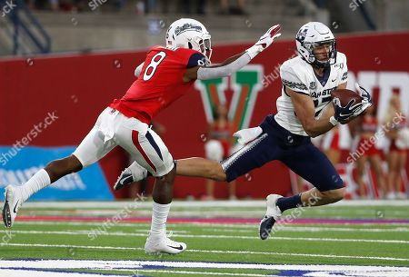 Caleb Repp, Chris Coleman. Utah State tight end Caleb Repp Fresno State safety Chris Coleman tries to defend during the first half of an NCAA college football game in Fresno, Calif