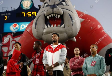 Fresno State alumnus Paul George of the Los Angeles Clippers watches the game against Utah State during the first half of an NCAA college football game in Fresno, Calif