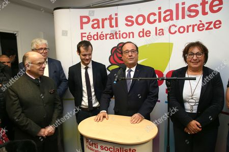 Former French President Francois Hollande and French former Prime Minister Bernard Cazeneuve with the socialist party's Federal Secretary of Correze region Paul Roche delivers a speech to the Socialist Party section