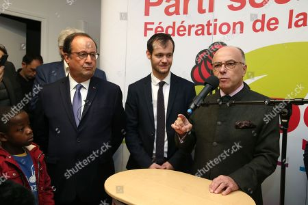Stock Photo of Former French President Francois Hollande and French former Prime Minister Bernard Cazeneuve with the socialist party's Federal Secretary of Correze region Paul Roche delivers a speech to the Socialist Party section during the 38th edition of the Foire du Livre de Brive book fair
