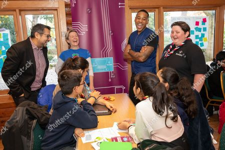 Stock Picture of Atif Ahmed (Plusnet), Olympia Brown (Rasberry Pi), Reggie Yates, Sam Murphy (Scouts) discuss ideas at the Plusnet and Scouts: Preparing for the Future digital camp