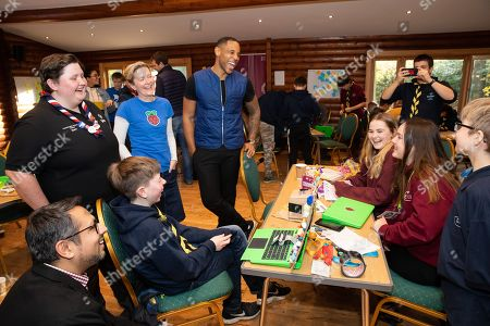 Stock Photo of Sam Murphy (Scouts), Olympia Brown (Rasberry Pi), Reggie Yates, Atif Ahmed (Plusnet) discuss ideas at the Plusnet and Scouts: Preparing for the Future digital camp