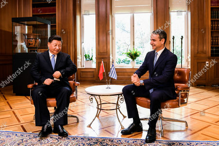 Greek Prime Minister Kyriakos Mitsotakis (R) speaks with Chinese President Xi Jinping (L) during their meeting at the Maximos Mansion in Athens, Greece, 11 November 2019, during his two-day official visit to the country.