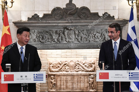 Chinese President Xi Jinping (L) speaks during a press conferense next to Greek Prime Minister Kyriakos Mitsotakis after their meeting at the Maximos Mansion in Athens, Greece, 11 November 2019, during his two-day official visit to the country.