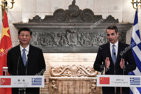 Greek Prime Minister Kyriakos Mitsotakis (R) speaks during a press conferense next to Chinese President Xi Jinping after their meeting at the Maximos Mansion in Athens, Greece, 11 November 2019, during his two-day official visit to the country.