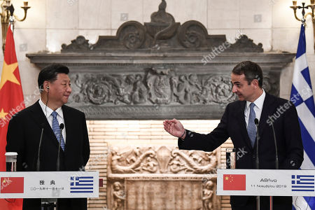 Stock Photo of Greek Prime Minister Kyriakos Mitsotakis (R) speaks during a press conferense next to Chinese President Xi Jinping after their meeting at the Maximos Mansion in Athens, Greece, 11 November 2019, during his two-day official visit to the country.
