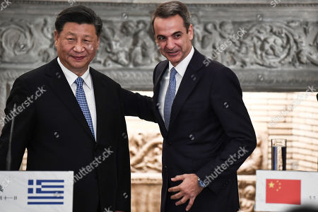 Chinese President Xi Jinping (L) and Greek Prime Minister Kyriakos Mitsotakis speak after their meeting at the Maximos Mansion in  Athens, Greece, 11 November 2019, during his two-day official visit to the country.