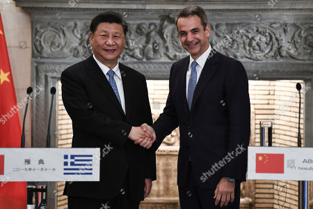 Stock Picture of Chinese President Xi Jinping (L) and Greek Prime Minister Kyriakos Mitsotakis shake hands after their meeting at the Maximos Mansion in  Athens, Greece, 11 November 2019, during his two-day official visit to the country.