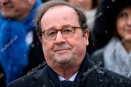 French former president Francois Hollande attends a ceremony at the Arc de Triomphe in Paris marking the 101st anniversary of the 1918 armistice, ending World War I