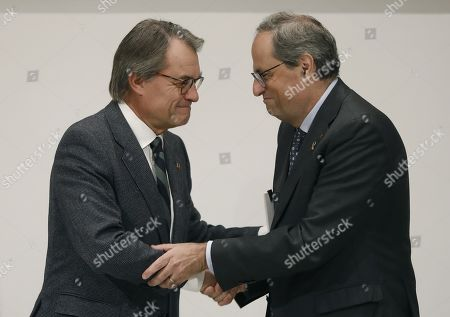 Catalan regional President Quim Torra (R) shakes hands with former regional President Artur Mas during an event to mark the 5th anniversary of the November 9th pro-independence referendum, in Barcelona, northeastern Spain, 11 November 2019. Mas, Homs, Ortega and Rigau were disqualified from holding office by Spanish court sfor their involvement in the referendum held in 2014.