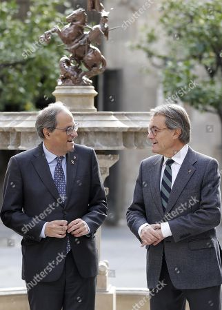 Catalan regional President Quim Torra (L) chats with former regional President Artur Mas (R) during an event to mark the 5th anniversary of the November 9th pro-independence referendum, in Barcelona, northeastern Spain, 11 November 2019. Mas, Homs, Ortega and Rigau were disqualified from holding office by Spanish court sfor their involvement in the referendum held in 2014.