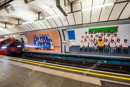 Yr 3 project posters on the platform billboards at Pimlico underground station - Steve McQueen's Year 3 project can now be seen as a large-scale installation at in the Duveen Galleries at Tate Britain. It is also on 600 billboards across all 33 of London's boroughs. The images feature class photos of Year 3 school children from London primary schools. The billboards are on high streets, railway platforms, roadside sites, and underground stations until mid-November