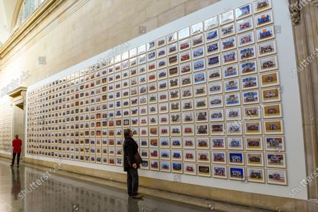 """Visitors view works at the preview of """"Year 3"""", an exhibition by Turner Prize-winning artist and Oscar-winning filmmaker Steve McQueen at Tate Britain.  The artwork comprises 3,128 traditional school class photographs of Year 3 pupils from 1,504 of London's primary schools.  The work reflects a picture of the present and is on display 12 November to 3 May 2020."""
