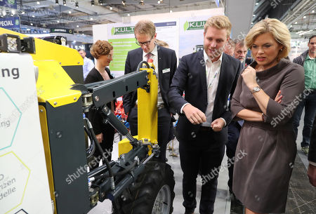 German Minister for Agriculture, Julia Kloeckner (R), looks at a machine for weed control during the Agritechnica trade show in Hannover, northern Germany, 11 November 2019. Agritechnica, which runs from 10 to 16 November, is the World's biggest fair for agricultural engineering with more than 2,750 exhibitors from 51 countries.