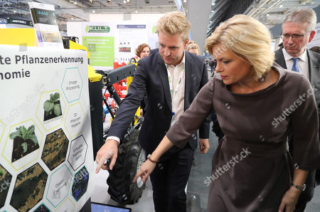 German Minister for Agriculture, Julia Kloeckner (R),visits the Agritechnica trade show in Hannover, northern Germany, 11 November 2019. Agritechnica, which runs from 10 to 16 November, is the World's biggest fair for agricultural engineering with more than 2,750 exhibitors from 51 countries.