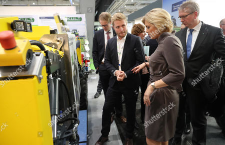 German Minister for Agriculture, Julia Kloeckner (2-R), looks at a machine for weed control during the Agritechnica trade show in Hannover, northern Germany, 11 November 2019. Agritechnica, which runs from 10 to 16 November, is the World's biggest fair for agricultural engineering with more than 2,750 exhibitors from 51 countries.