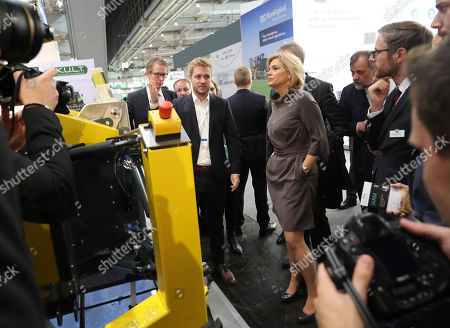 German Minister for Agriculture, Julia Kloeckner (C-R), looks at a machine for weed control during the Agritechnica trade show in Hannover, northern Germany, 11 November 2019. Agritechnica, which runs from 10 to 16 November, is the World's biggest fair for agricultural engineering with more than 2,750 exhibitors from 51 countries.