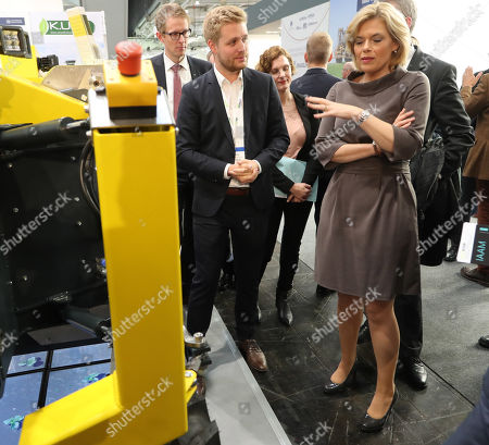 German Minister for Agriculture Julia Kloeckner (R) looks at a machine for weed control during the Agritechnica trade show in Hannover, northern Germany, 11 November 2019. Agritechnica, which runs from 10 to 16 November, is the World's biggest fair for agricultural engineering with more than 2,750 exhibitors from 51 countries.