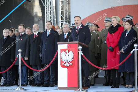 President of Poland Andrzej Duda (5-R) speaks during a ceremony commemorating Polish independence Day at the Tomb of the Unknown Soldier at the Jozef Pilsudski Square in Warsaw, Poland, 11 November 2019. President is accompanied by his wife Agata Kornhauser-Duda (4-R).