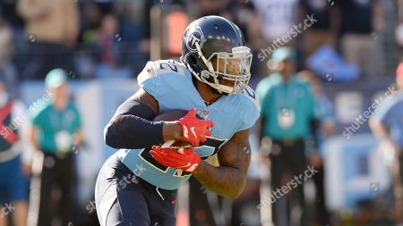 Tennessee Titans running back Derrick Henry plays against the Kansas City Chiefs in the first half of an NFL football game, in Nashville, Tenn