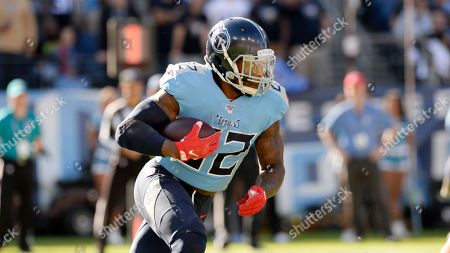 Stock Image of Tennessee Titans running back Derrick Henry carries the ball against the Kansas City Chiefs in the first half of an NFL football game, in Nashville, Tenn