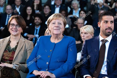 (L-R) Minister of State at the Chancellery for Migration, Refugees and Integration Annette Widmann-Mauz, German Chancellor Angela Merkel and soccer player of Serie A club Juventus Sami Khedira attend the award ceremony of the National Integration Prize at the chancellery in Berlin, Germany, 11 November 2019.  Federal Chancellor's National Integration Prize is awarded to individuals, groups of people, organizations or communities that have made an exemplary contribution to the integration of migrants.