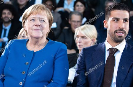 Stock Image of German Chancellor Angela Merkel (L) and soccer player of Serie A club Juventus Sami Khedira attend the award ceremony of the National Integration Prize at the chancellery in Berlin, Germany, 11 November 2019.  Federal Chancellor's National Integration Prize is awarded to individuals, groups of people, organizations or communities that have made an exemplary contribution to the integration of migrants.