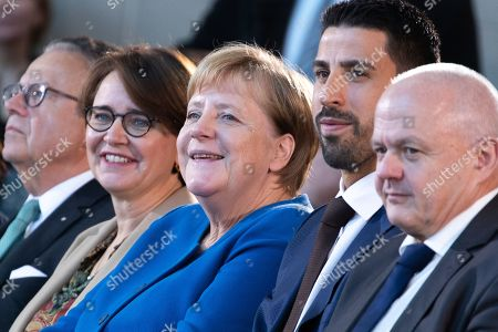 Minister of State at the Chancellery for Migration, Refugees and Integration Annette Widmann-Mauz (2L), German Chancellor Angela Merkel (C) and soccer player of Serie A club Juventus Sami Khedira (2-R) attend the award ceremony of the National Integration Prize at the chancellery in Berlin, Germany, 11 November 2019.  Federal Chancellor's National Integration Prize is awarded to individuals, groups of people, organizations or communities that have made an exemplary contribution to the integration of migrants.