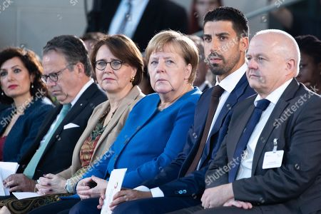 Minister of State at the Chancellery for Migration, Refugees and Integration Annette Widmann-Mauz (CL), German Chancellor Angela Merkel (CR) and soccer player of Serie A club Juventus Sami Khedira (2R) attend the award ceremony of the National Integration Prize at the chancellery in Berlin, Germany, 11 November 2019.  Federal Chancellor's National Integration Prize is awarded to individuals, groups of people, organizations or communities that have made an exemplary contribution to the integration of migrants.
