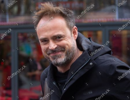 Jamie Theakston leaves the studios in Leicester Square.