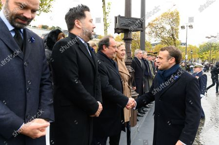 Emmanuel Macron and Francois Hollande attends a ceremony at the Arc de Triomphe in Paris