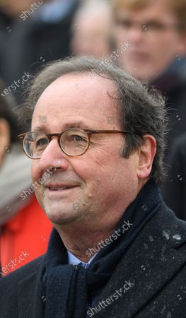 Francois Hollande attends a ceremony at the Arc de Triomphe in Paris
