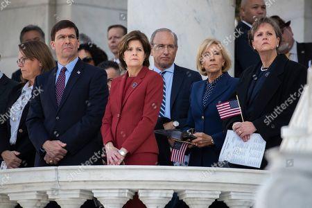 Mark Esper, Betsy DeVos, Mike Pence. Defense Secretary Mark Esper, second from left, and Education Secretary Betsy DeVos, second from right, attend the 66th annual National Veterans Day observance at Arlington National Cemetery, in Arlington, Va
