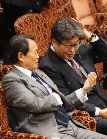 Stock Photo of Japanese Education Minister Koichi Hagiuda (R) chats with Finance Minister Taro Aso before starting Upper House's budget committee session at the National Diet.