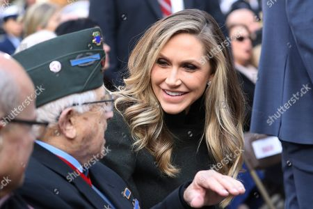 Stock Picture of Lara Trump talks to guests before President Donald Trump and first lady Melania Trump arrive at the New York City Veterans Day Parade at Madison Square Park in New York
