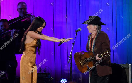 Stock Picture of Kacey Musgraves and Willie Nelson