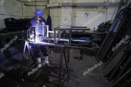 Egyptian inmates work at metal workshop inside Tora prison during Human Rights commission visit in Cairo, Egypt, 11 November 2019. According to reports, a delegation comprising members of Human Rights commission, parliamentarians and journalists visited Tora Prison ahead of the Universal Periodic Review (UPR) of Egypt before the UN Human Rights Council scheduled for 13 November and after a UN report on 08 November claimed 'inadequate prison conditions' may have led to the death of ousted president Mohamed Morsi.