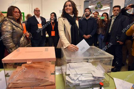 Ines Arrimadas Garcia casts her vote in a ballot box at the polling station during the general elections.