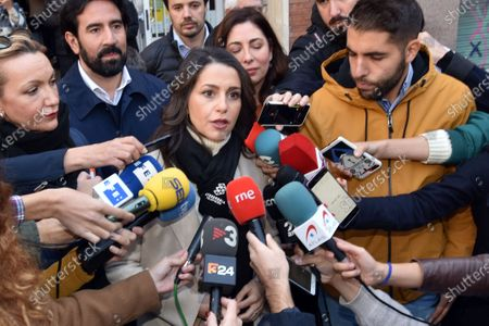 Ines Arrimadas Garcia speaks to the media at the polling station during the general elections.