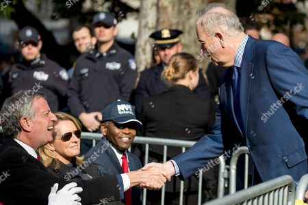 Stock Picture of Bill O'Reilly, Bill de Blasio. Bill O'Reilly, right, greets New York Mayor Bill de Blasio, left, before President Donald Trump and first lady Melania Trump participate in a wreath laying ceremony at the New York City Veterans Day Parade at Madison Square Park, in Washington