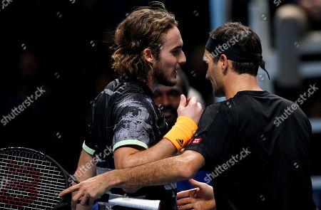 Stock Photo of Stefanos Tsitsipas of Greece shakes hands with Roger Federer of Switzerland